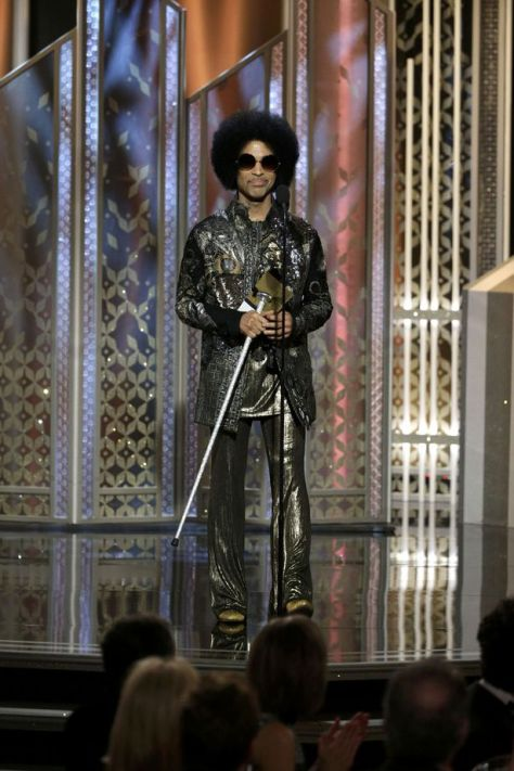 Musician-Prince-presents-at-the-72nd-Golden-Globe-Awards-in-Beverly-Hills-California-January-11-2015
