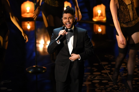 HOLLYWOOD, CA - FEBRUARY 28: Singer The Weeknd performs onstage during the 88th Annual Academy Awards at the Dolby Theatre on February 28, 2016 in Hollywood, California. (Photo by Kevin Winter/Getty Images)