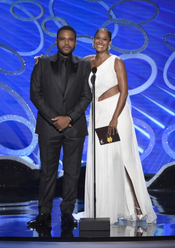 Anthony Anderson, left, and Tracee Ellis Ross present an award at the 68th Primetime Emmy Awards on Sunday, Sept. 18, 2016, at the Microsoft Theater in Los Angeles. (Photo by Chris Pizzello/Invision/AP)