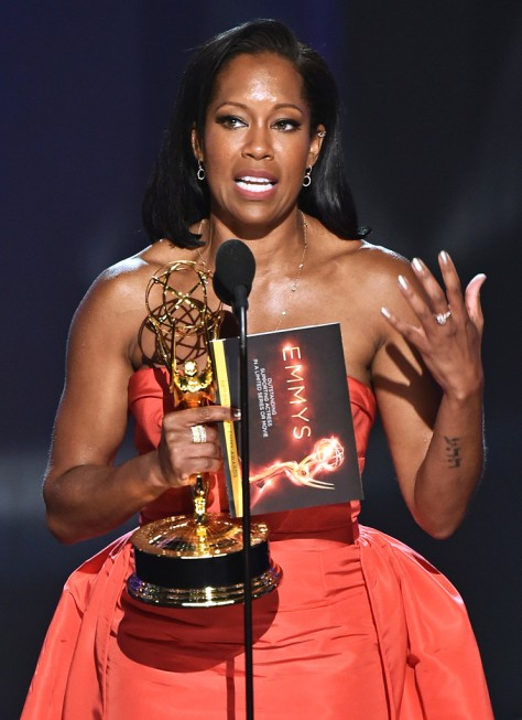 "Regina King accepts the award for outstanding supporting actress in a limited series or movie for ""American Crime"" at the 68th Primetime Emmy Awards on Sunday, Sept. 18, 2016, at the Microsoft Theater in Los Angeles. (Photo by Vince Bucci/Invision for the Television Academy/AP Images)"