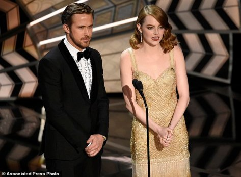 Ryan Gosling, left, and Emma Stone introduce a performance at the Oscars on Sunday, Feb. 26, 2017, at the Dolby Theatre in Los Angeles. (Photo by Chris Pizzello/Invision/AP)